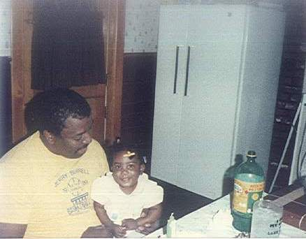 me and my father Larry on my 1st bday.
